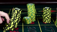 Chips fall on green roulette table at casino, slow motion Stock Footage