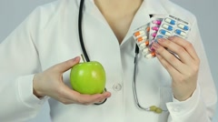 Hospital doctor prescribing medical treatment and healthy diet to ill patient Stock Footage