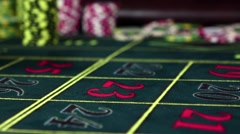 Gambling chips falling down on the roulette table, slow motion - stock footage