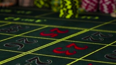 Blue gambling chip falling down on roulette table, slow motion Stock Footage