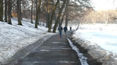 Man Jogging Spring Park. Stock Footage