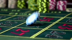Two different gambling chip falling on roulette table, slow motion Stock Footage