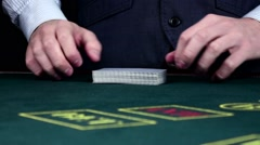 Stock Video Footage of Croupier shuffling cards, shows them at the casino, slow motion