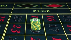 Green-yellow poker chips on gaming table, winning chip, slow motion Stock Footage