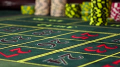 Gambling chips black, blue falling on roulette table, slow motion - stock footage