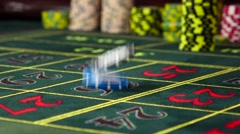 Two gambling chips falling down on roulette table, slow motion Stock Footage