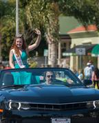 Parade queen in car with her driver Stock Photos