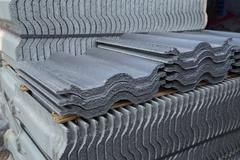 Stack of concrete roof tile (gray color) at construction site Stock Photos