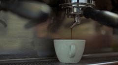 Barista making coffee in coffeeshop. Close up - stock footage