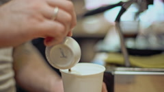 Barista making coffee in coffeeshop. Close up. Slow motion Stock Footage