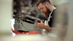 Barista making coffee in coffeeshop. Close up. Slow motion - stock footage