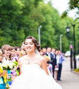 happy bride with guests - stock photo