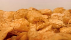 Potato Chips Rotating On Plate Stock Footage