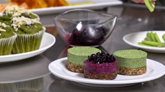 Servings of delicious desserts. Close up. Slow motion Stock Footage
