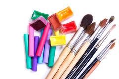 Brushes, pastel and water color paints Stock Photos
