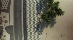 Overhead aerial shot of Copacabana Beach iconic sidewalk Stock Footage