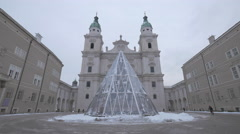 Fountain covered in glass in front of Salzburg Cathedral in Salzburg Stock Footage