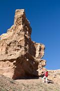 Woman travel among rocks Stock Photos