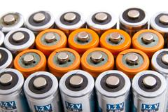 Several AA batteries in perspective closeup view - stock photo