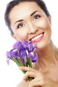 Young asian model with iris flowers. Stock Photos