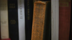 Holy Bible on Bookshelf that is a Antique, 4K Stock Footage