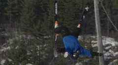 Winter Slow Motion Extreme Sports - Back flip on skis - stock footage
