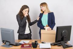 Office worker with tears accompanies the dismissed colleague Stock Photos