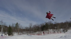 Stock Video Footage of Extreme Ski Tricks - front Flip on a big jump