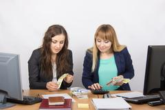 For office table girl enthusiastically believe the money - stock photo