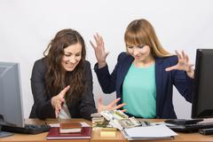 Two office employee greedy hands to pull a wad of money - stock photo