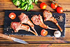 Rack of lamb fried with aromatic olive oil - stock photo