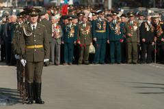 Soldiers of guard of honor at veterans background Kuvituskuvat