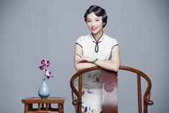 Portrait of young beautiful woman in traditional cheongsam - stock photo