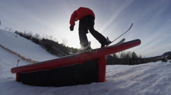 Skiing at golden hour - rail grind extreme slow motion Stock Footage