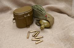 Army still life on the background fabric Stock Photos