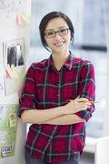 Female designer working in office - stock photo