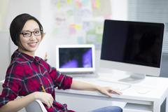 Stock Photo of Portrait of young woman in office