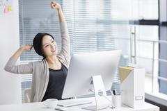 Young woman relaxing in office - stock photo