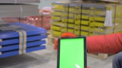 Man holding tablet with green screen in industry Stock Footage