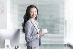 Businesswoman taking a coffee break - stock photo