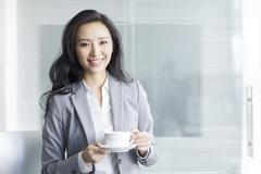 Businesswoman taking a coffee break - stock photo