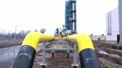 yellow pipe on gas plant. shot with slider - stock footage