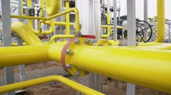 Yellow pipe on gas plant. shot with slider Stock Footage