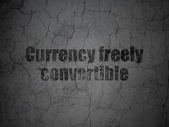 Currency concept: Currency freely Convertible on grunge wall background - stock illustration