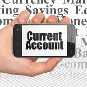 Currency concept: Hand Holding Smartphone with Current Account on display Stock Illustration