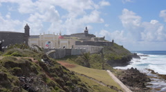 View of El Morro Castle and cemetery next to ocean Stock Footage