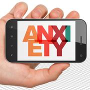 Stock Illustration of Medicine concept: Hand Holding Smartphone with Anxiety on  display