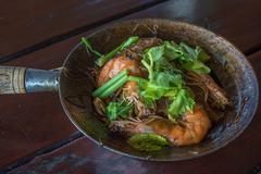 Baked shrimps with glass noodles, authentic Thai cuisine Stock Photos