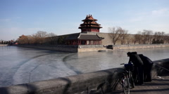 People fishing in the frozen moat around forbidden city Stock Footage