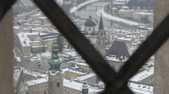 Salzach river and churches seen through a fence in Salzburg Stock Footage